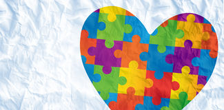 composite-image-autism-awareness-heart-against-crumpled-white-page-53739728